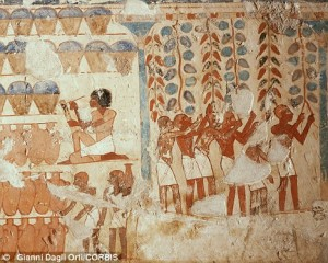 This hieroglyph shows Egyptians harvesting grapes and counting jars of wine. Researchers say traces from two jars show herbs and wine were mixed for the sick as far back as 3,150BC